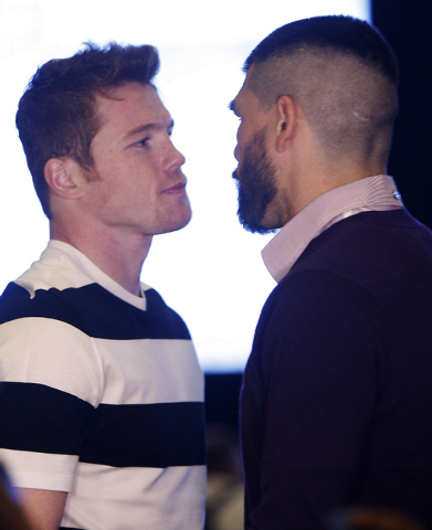 "Boxers Canelo Alvarez, left, and Alfredo Angulo engage in a spontaneous ""face off"" after arriving at the MGM Grand prior to their junior middleweight fight in Las Vegas on Tuesday, March ..."