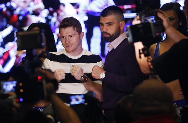 Boxers Canelo Alvarez, left, and Alfredo Angulo pose together for photographs after arriving at the MGM Grand prior to their junior middleweight fight in Las Vegas on Tuesday, March 4, 2014. (Jaso ...