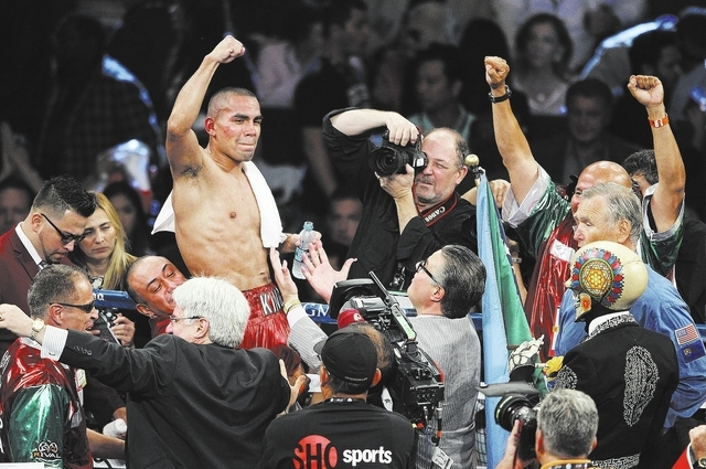 Carlos Molina celebrates his victory over Ishe Smith for the IBF Junior Middleweight title at the MGM Grand Garden Arena in Las Vegas on Sept. 14, 2013. (Jason Bean/Las Vegas Review-Journal)