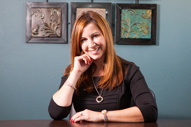 Holly L. Silvestri, principal of The Ferraro Group, poses for a portrait at the office's location at 9516 W. Flamingo Road, #310, in Las Vegas on Thursday, Feb. 20, 2014. (Chase Stevens/Las Vegas  ...