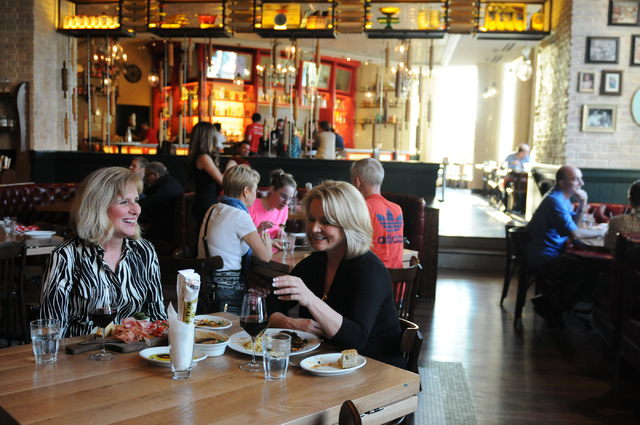 Deborah Dort, left, and her friend Stacy DePriest, dine at Buddy V's Ristorante at the Grand Canal Shoppes at The Venetian casino-hotel in Las Vegas Saturday, March 22, 2014. (Erik Verduzco ...