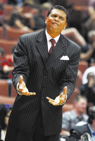 Cal State Northridge coach Reggie Theus pleads with his players in the first half of an NCAA college basketball game against Cal Poly for the Big West men's tournament title in Anaheim, Calif., Sa ...