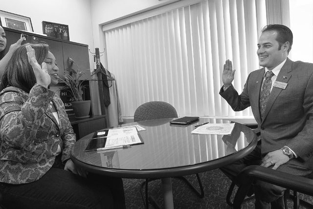 Democratic gubernatorial candidate Chris Hyepock, right, gets sworn in by Election Filing Officer Adreane Freeman as he officially files to run for office against incumbent Gov. Brian Sandoval at  ...