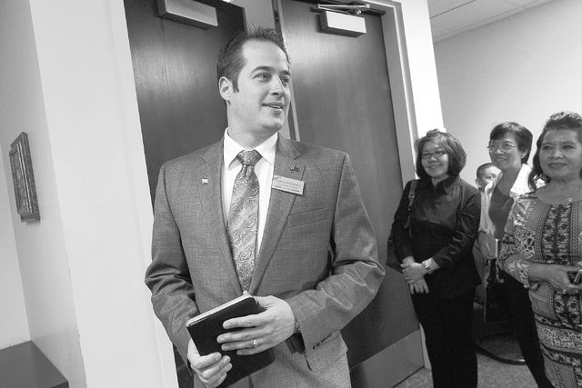 Democratic gubernatorial candidate Chris Hyepock, left, arrives at the Grant Sawyer building to officially file to run for office against incumbent Gov. Brian Sandoval in Las Vegas on March 14, 20 ...