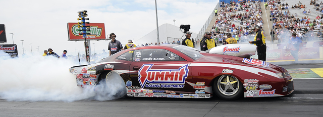 NHRA Pro Stock driver Jimmy Alund performs a burnout before the third qualifying session of the SummitRacing.Com Nationals at The Strip at Las Vegas Motor Speedway in Las Vegas Saturday, March 29, ...