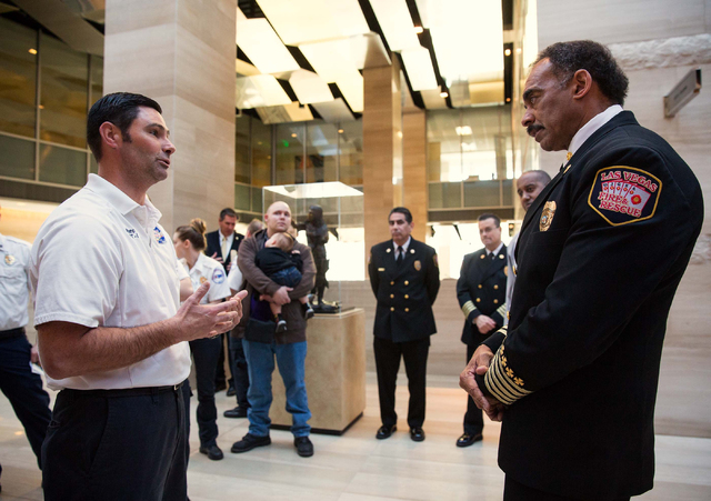 American Medical Response emergency medical technician Marc Winburn (cq), left, talks with City of Las Vegas Fire Chief William McDonald following McDonald's report to the City Council at City Hal ...