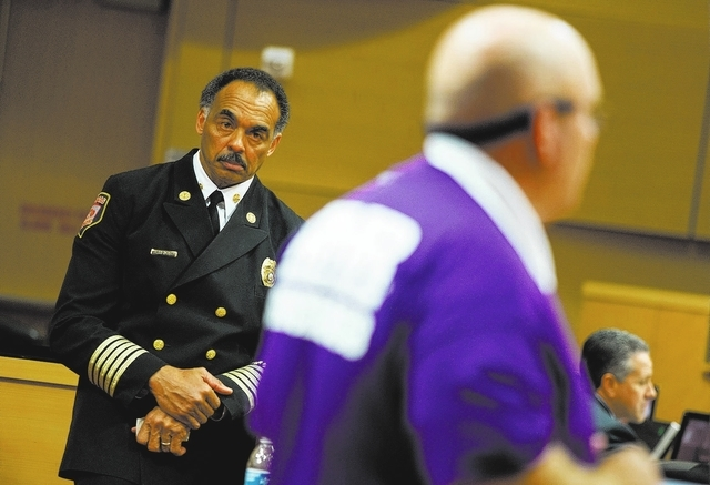City of Las Vegas Fire Chief William McDonald, left, listens as American Medical Response paramedic Roy Keefer (cq) gives remarks during public comment at the Las Vegas City Council meeting Wednes ...