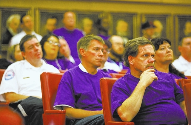 Steven Shepherd, bottom right, with American Medical Response, listens during the Las Vegas City Council meeting Wednesday, March 5, 2014 at City Hall. City of Las Vegas Fire Chief William McDonal ...