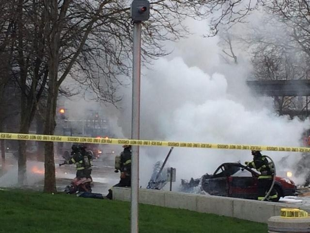 Emergency personnel respond to the scene of a helicopter crash outside the KOMO-TV studios near the Space Needle in Seattle on Tuesday morning. The station says the helicopter was apparently lifti ...