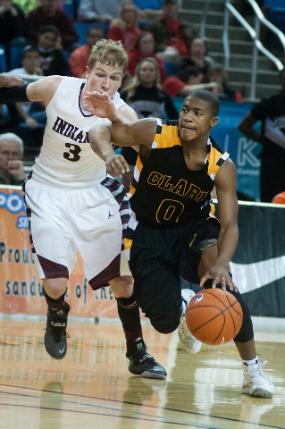 Clark's Colby Jackson (0) drives past Elko's Marshall Dumas (3) during the Division I -A state final on Saturday. Clark defeated Elko 43-25. (Kevin Clifford/Las Vegas Review-Journal)