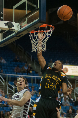 Clark's Ty'Rek Wells (13) attempts a dunk against Elko during the Division I -A state final on Saturday. Clark defeated Elko 43-25. (Kevin Clifford/Las Vegas Review-Journal)