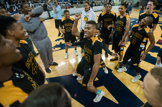Clark's Ty'Rek Wells (13) dances with teammates after the Chargers beat Elko 43-25 for the Division I -A state title on Saturday. (Kevin Clifford/Las Vegas Review-Journal)