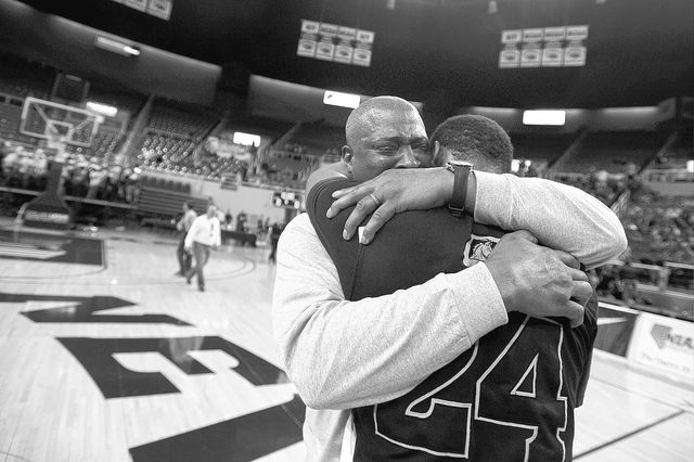 David Jones, father of Diontae Jones (24), cries while celebrating with his son after Clark High School defeated Elko High School in the Division I -A state finals on Saturday, March 1, 2014 in Re ...