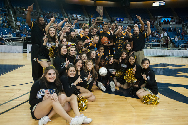 Clark High School players and cheerleaders pose for photographers after the team won the Division I -A state finals on Saturday, March 1, 2014 in Reno, Nevada.  Clark defeated Elko 43-25. (Kevin C ...