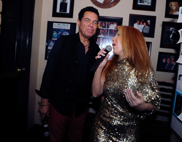 Husband and wife singers Clint Holmes, left, and Kelly Clinton appear off stage together during open mic night at the Bootlegger Bistro on Monday, March 3, 2014. (David Becker/Las Vegas Review-Jou ...