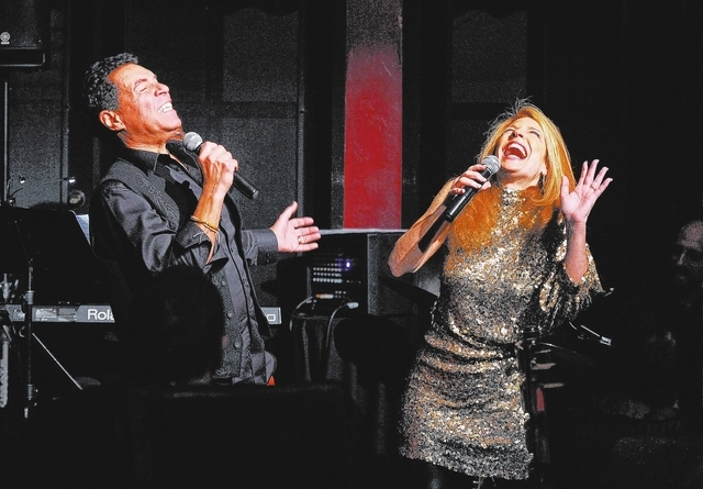 Husband and wife singers Clint Holmes, left, and Kelly Clinton share a laugh while on stage together during open mic night at the Bootlegger Bistro on Monday, March 3, 2014. (David Becker/Las Vega ...