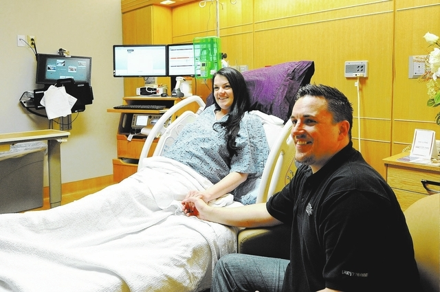 Blair Empey and Johnathan Leavitt hold hands in a labor room in the women's services area at Centennial Hills Hospital in Las Vegas, Wednesday, Feb. 26, 2014. (Jerry Henkel/Las Vegas Review-Journal)