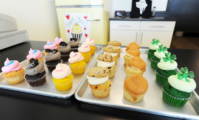Cupcakes are seen at the Retro Bakery in Las Vegas, Tuesday, March 11, 2014. From left, the cupcake flavors are: cotton candy, cookies & cream, pink lemonade, milk & cookies, hop scotch and the mo ...
