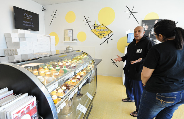 Randy Cadiz, of Las Vegas, left, discusses a custom cake order with employee Erica Frizzell, right, at the Retro Bakery in Las Vegas, Tuesday, March 11, 2014. (Jerry Henkel/Las Vegas Review-Journal)