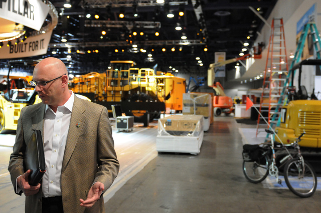Steve Moster, president at Global Experience Specialists, is interviewed inside the CONEXPO-CON/AGG showroom at the Las Vegas Convention Center in Las Vegas Thursday, Feb. 27, 2014. The event is s ...