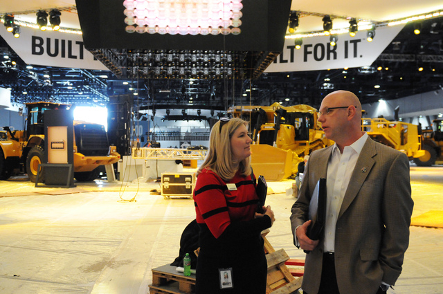 Steve Moster, president at Global Experience Specialists, right, and public relations manager Detra Page, talk to each other during a tour of the CONEXPO-CON/AGG showroom inside the Las Vegas Conv ...