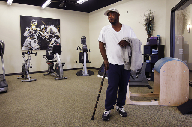 Brian Snoddy, a resident of Nevada's 1st Congressional District since 2011, listens to his therapist before leaving Dynamic Spine & Sport Rehabilitation in Las Vegas on March 26, 2014. Snoddy, who ...
