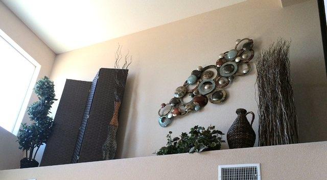 High pot shelf creates decorating opportunity las vegas for Pot shelf decorating ideas