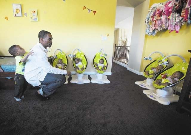 Deon Derrico with six of his nine children at their home in North Las Vegas on Monday, March 24, 2014. His wife Evonne Derrico gave birth to quintuplets on Sept. 6.(Jeff Scheid/Las Vegas Review-Jo ...