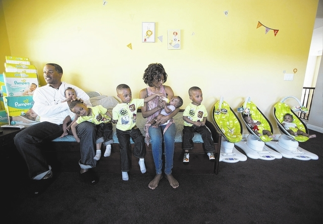 Deon Derrico,left, and his wife Evonne with their seven of their nine children at their home in North Las Vegas on Monday, March 24, 2014. Evonne Derrico gave birth to quintuplets on Sept. 6.(Jeff ...