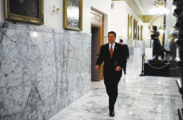 Nevada Gov. Brian Sandoval walks through the Capitol on Friday morning, March 7, 2014, to file for re-election in the Secretary of State's office in Carson City, Nev. (Cathleen Allison/Las Vegas R ...