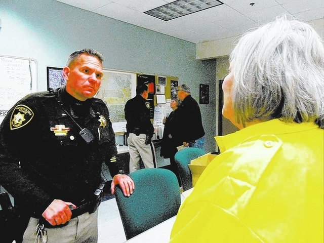 Lt. John Pelletier of the Metropolitan Police Department speaks with a resident Feb. 4 during a 1st Tuesday event at the Northwest Area Command, 9850 W. Cheyenne Ave. The department's next 1st T ...