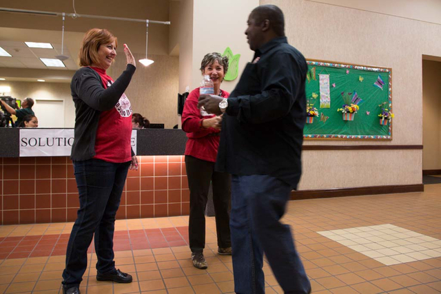 Culinary Workers Union, Local 226 staff members (names withheld) show their support and guide members to the meeting sign-in table at the East Las Vegas Community Center on Thursday, March 27, 201 ...