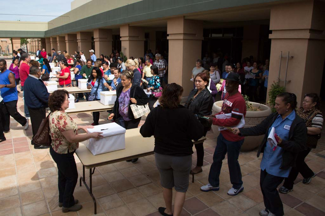 Culinary Workers Union, Local 226 members flood from the meeting hall into the courtyard to cast their ballots at the East Las Vegas Community Center on Thursday, March 27, 2014. Both culinary wor ...