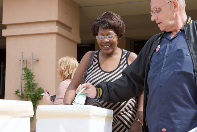 35 year Culinary Union Member and El Cortez employee, Linda Hunt, accepts cast ballots at the East Las Vegas Community Center on Thursday, March 27, 2014. Both culinary workers and members of Brad ...