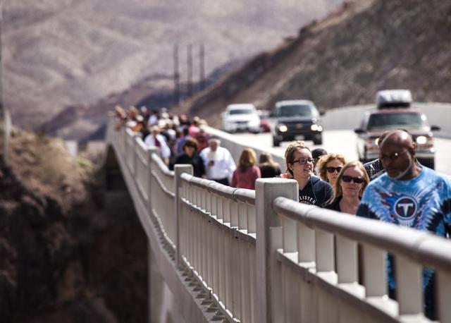People walk on top of the  OՃallaghan-Tillman Memorial Bridge on Thursday, March 20, 2014.  The world's highest concrete arch bridge was open in 2010.(Jeff Scheid/Las Vegas Review-Journal)
