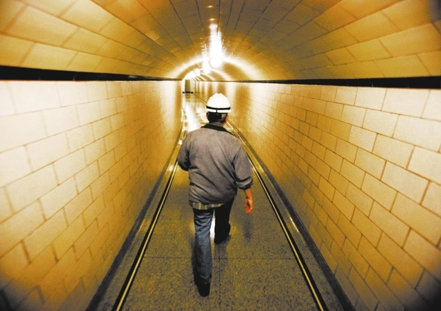 William Schermerhorn, supervisory apprentice coordinator, walk down a hall inside Hoover Dam on Thursday, March 20, 2014.Almost two-fifths of the workforce at the federal facility is expected to r ...