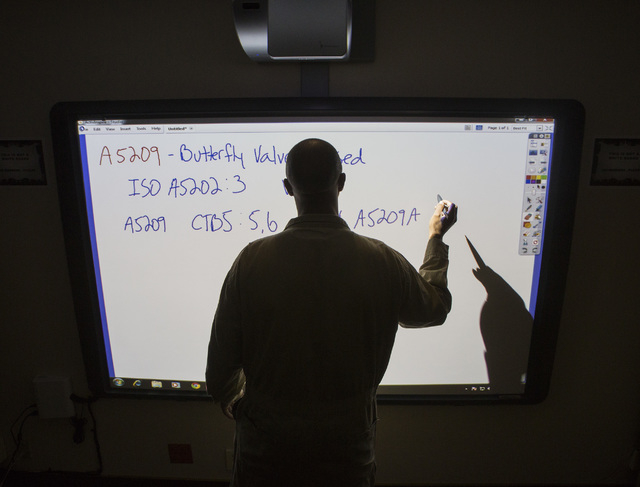 Intern Cecil Levy during a  system electrician apprentice class at Hoover Dam on Thursday, March 20, 2014.Almost two-fifths of the workforce at the federal facility is expected to retire within th ...