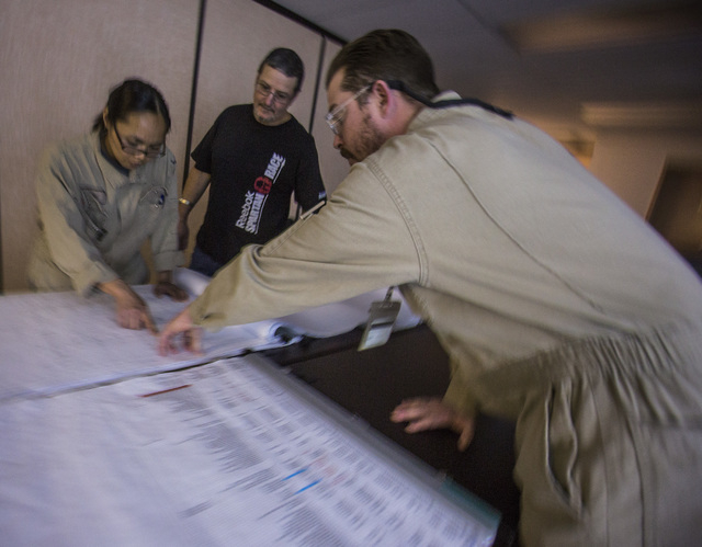 Lee Holt, right, instructs interns Peni Dela Pema and Fouglas Ashford during a  system electrician apprentice class at Hoover Dam on Thursday, March 20, 2014.Almost two-fifths of the workforce at  ...