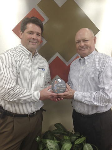 Courtesy photo Bart Peterson, Friendly Ford Fleet Manager, left, accepts the Southwest Gas Honorary Partner honor from William R. Jackson, Southwest Gas manager of corporate purchasing and invento ...
