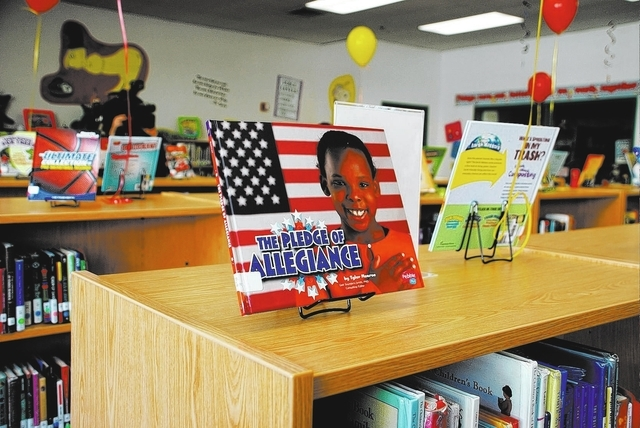 One of more than 600 new books donated as part of a library upgrade at Eva Wolfe Elementary School, 4027 W. Washburn Road, in January. The upgrade, backed by a $50,000 donation from nonprofit Gene ...