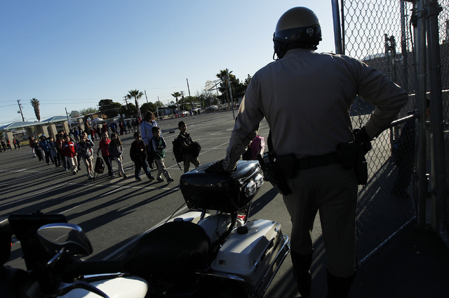 Metro Officer Laythorpe watches as students arrive safely at Halle Hewetson Elementary School. The Las Vegas Metropolitan Police Department Downtown Area Command worked with the school to introduc ...