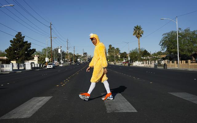 Metro Officer Aden Ocampogomez, dressed up as a duck, watches traffic stop as he crosses Bonanza Road heading toward Halle Hewetson Elementary School on Wednesday. The Las Vegas Metropolitan Polic ...