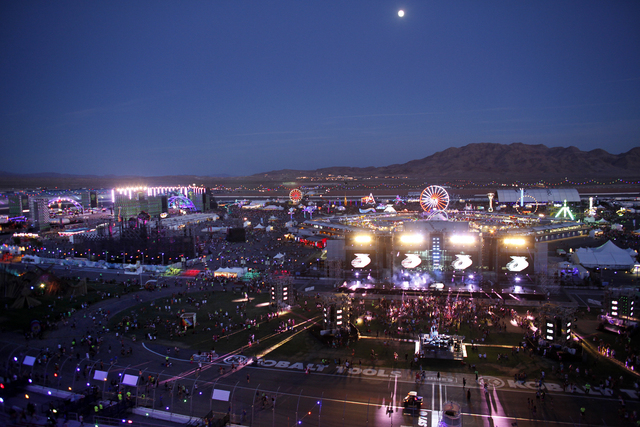 Crowds start to fill in the Las Vegas Motor Speedway for the Electric Daisy Carnival on June 21, 2013. (John Locher/Las Vegas Review-Journal)