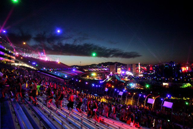 The sun rises in the east near the end of the second night of the Electric Daisy Carnival at the Las Vegas Motor Speedway early June 23, 2013. (Jessica Ebelhar/Las Vegas Review-Journal)