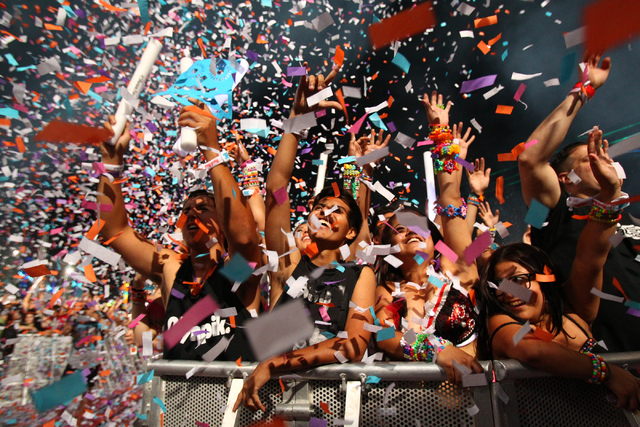 Festival-goers watch Steve Angello at Kinetic Field as confetti goes off at the Electric Daisy Carnival at the Las Vegas Motor Speedway in the early hours of June 24, 2013. (Chase Stevens/Las Vega ...