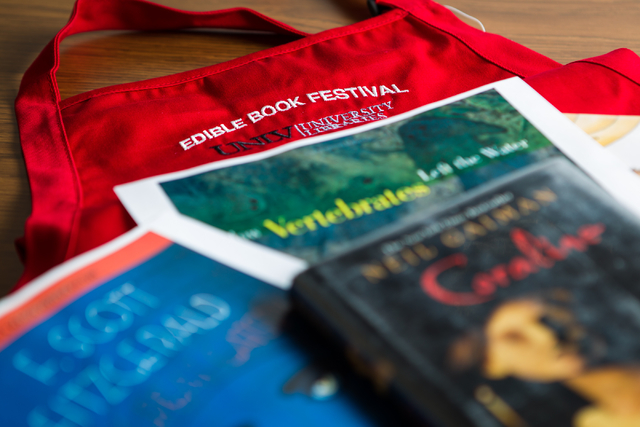 An apron, one of the prizes for the Edible Book Festival, is seen with some of the books which have been chosen as entries at the Lied Library at the University of Nevada, Las Vegas on Thursday, M ...