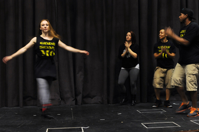 Elaine Alcorn, from left, twirls in place as fellow Molodi members clap to the beat, Harmony Costa, Angie Freeman, and Antwan Davis, during a rehearsal for their upcoming show at Inspire Theater i ...