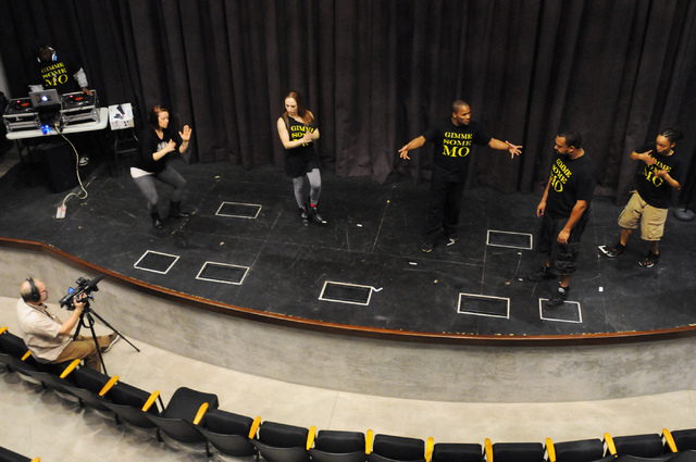 Rashad Mullins, from left, plays music during a rehearsal by Molodi members Harmony Costa, Elaine Alcorn, Jason Nious, Antwan Davis and Angie Freeman for their upcoming show at Inspire Theater in  ...
