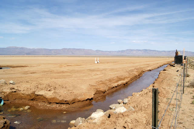 A canal is seen running from a well on Jim Rhodes' farm about 20 miles north of Kingman, Ariz. Friday, March 28, 2014. The builder has left his hammer in Las Vegas and taken up farming on portions ...