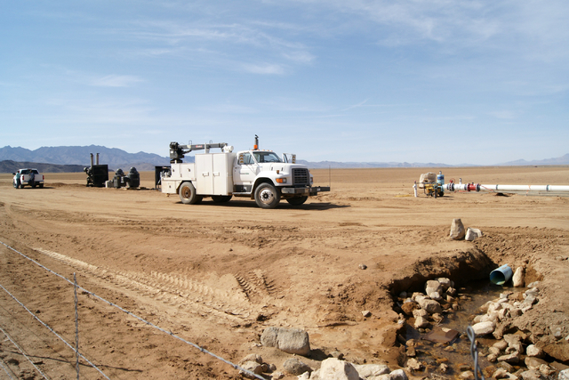 Well engines and irrigation equipment are seen on Jim Rhodes' farm about 20 miles north of Kingman, Ariz. Friday, March 28, 2014. The builder has left his hammer in Las Vegas and taken up farming  ...
